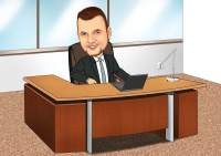 Chef im Sessel